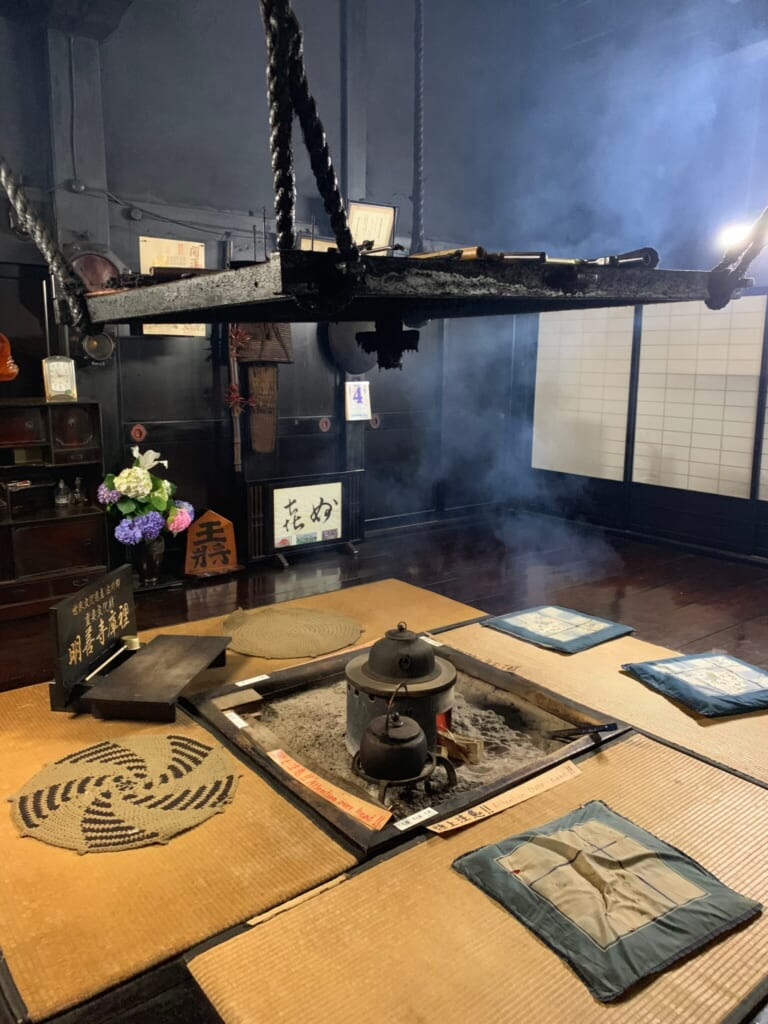 Japanese sunken hearth surrounded by tatami room in traditional JApanese house in Gifu, Japan