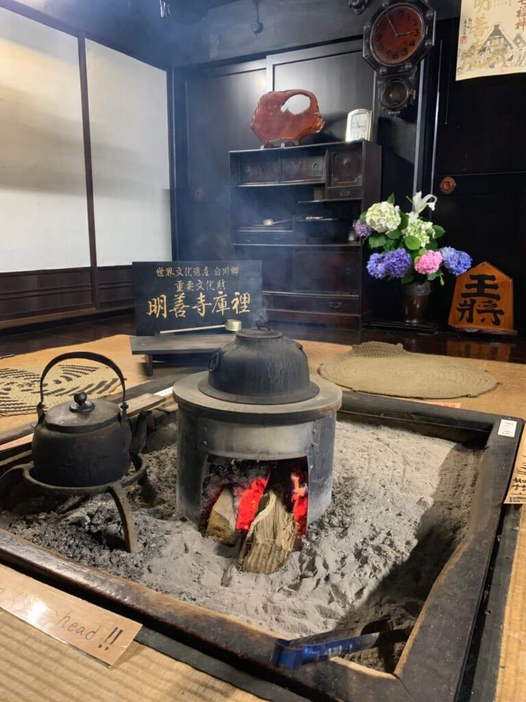 close-up of smoking irori with burning wood in traditional JApanese house in Gifu, Japan