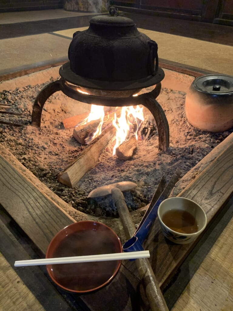 wood fire burning in hearth in JApanese house