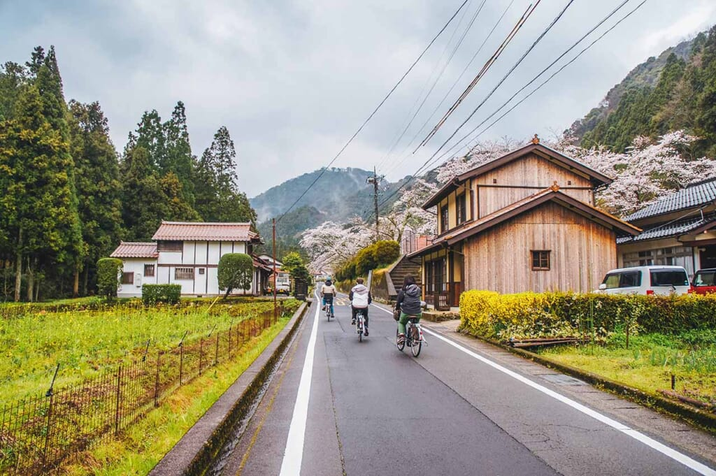 cycling in Japan on bicycles through rural streets of the Japanese countryside