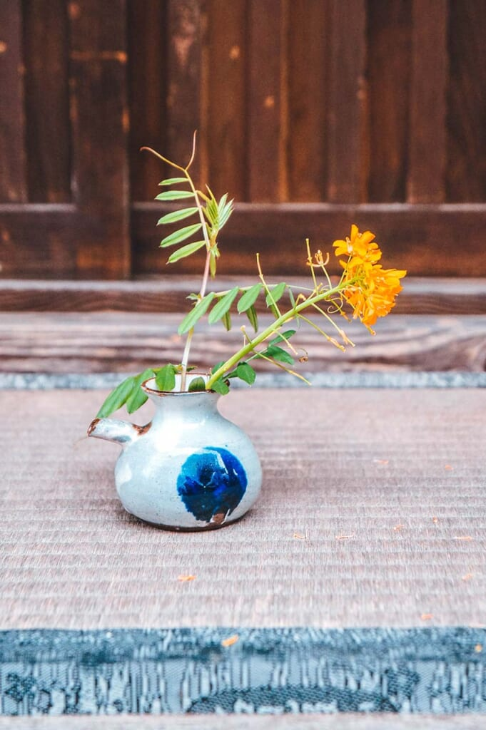 small flowers in Japanese vase a typical wabi sabi approach in Japan