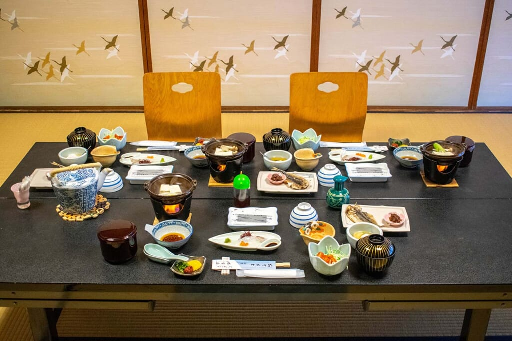 traditional Japanese meal set on table within a ryokan inn in Japan