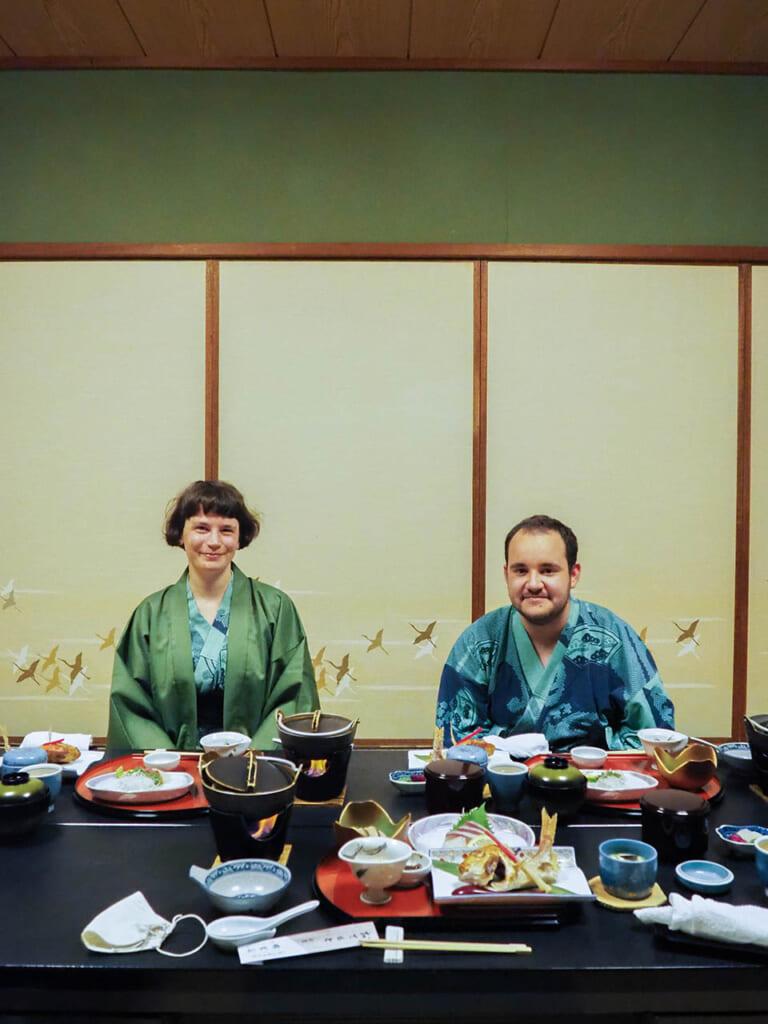 two people in kimono at dinner in Japanese ryokan inn