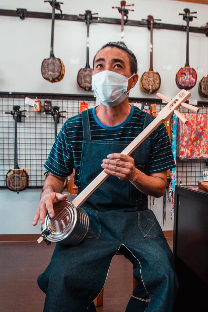 machida-san with a kankara sanshin, traditional japanese instrument