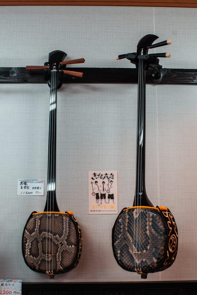 two Okinawan sanshin instruments in the wall in Japan