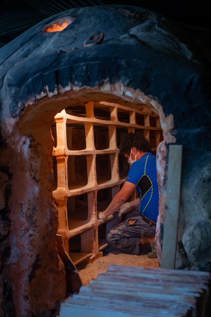 a person working in a Japanese climbing kiln in Okinawa
