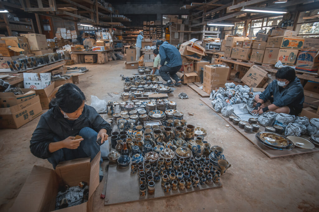 people working with japanese ceramics in matsuda workshop in okinawa