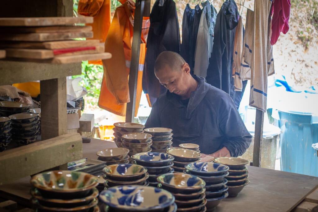 a man making japanese ceramics in okinawa