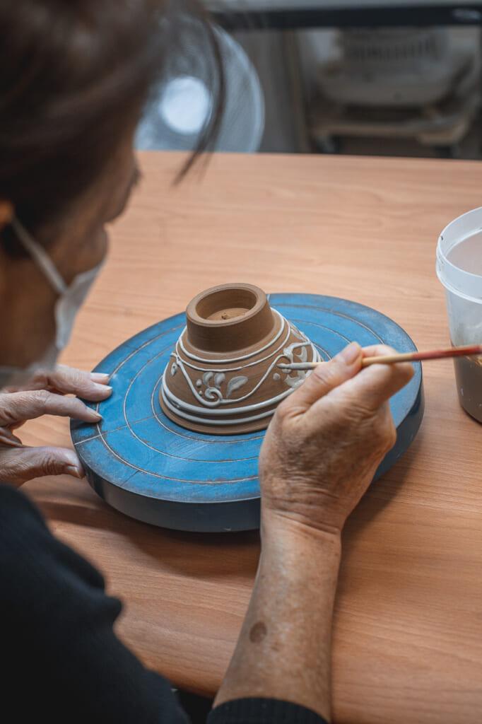 white design in a ceramic bowl in Okinawa, Japan