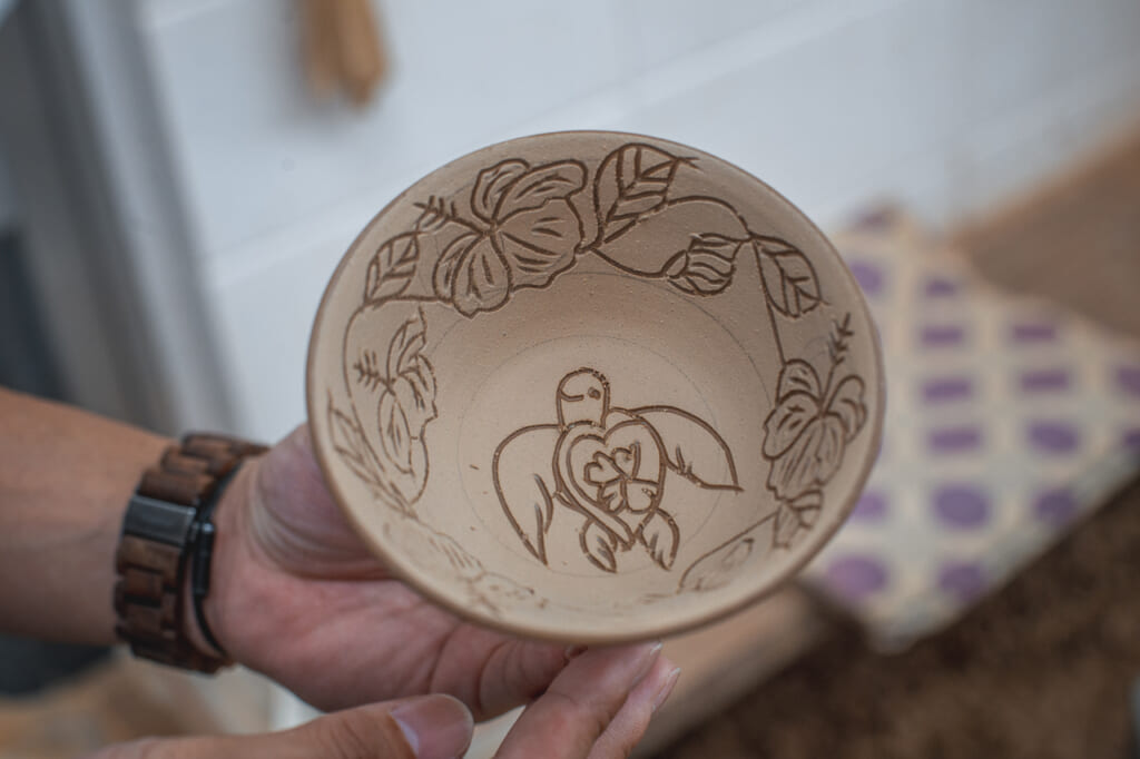 a smiling turtle carved in a bowl in Okinawa, Japan