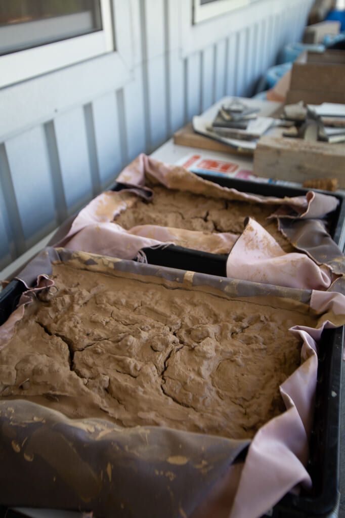 red clay is used to create japanese pottery