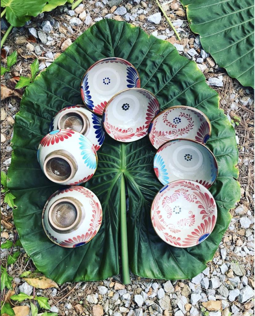 eight ceramic bowls on a big leaf in Okinawa, Japan