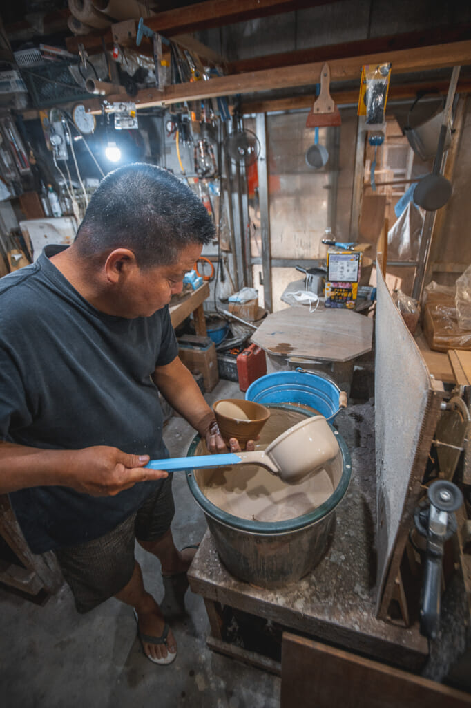 Nakama's brother working in the workshop  in Okinawa, Japan
