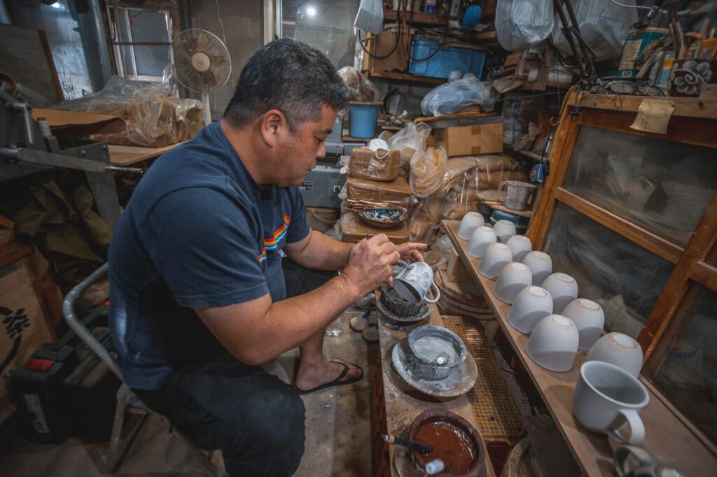 Nakama-san working in his workshop in Okinawa, Japan