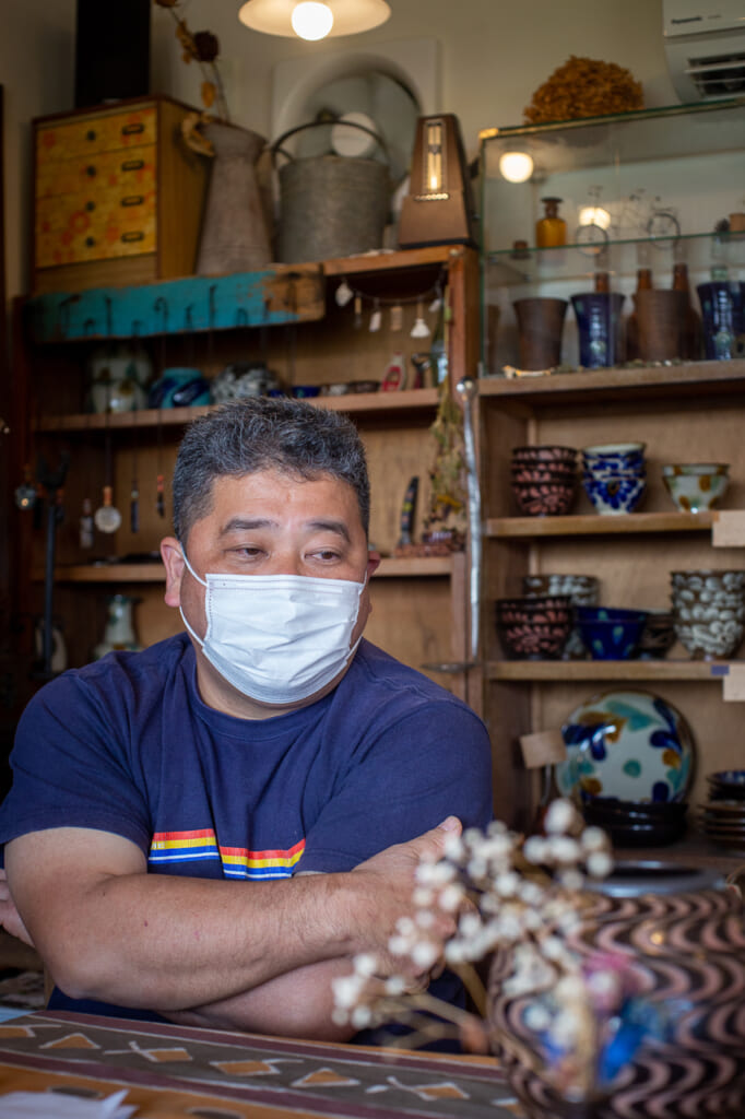 portrait of a Isao Nakama in his shop in Okinawa