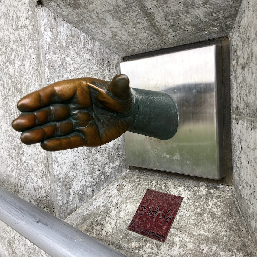 Bronze sculpture of extended hand in Japan