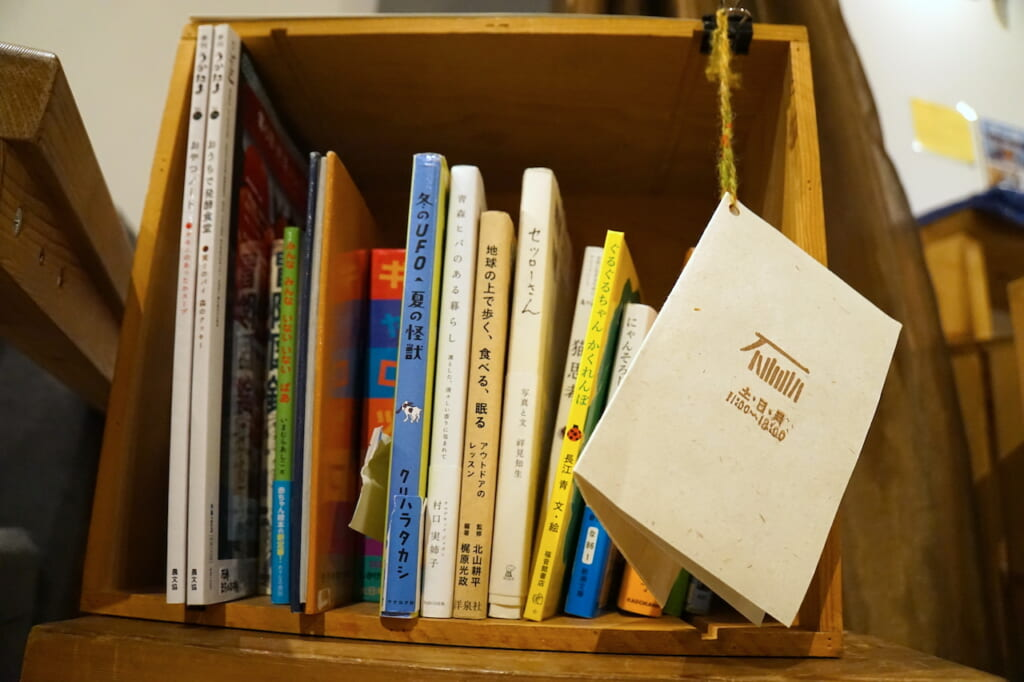 books displayed in a square box in Japan