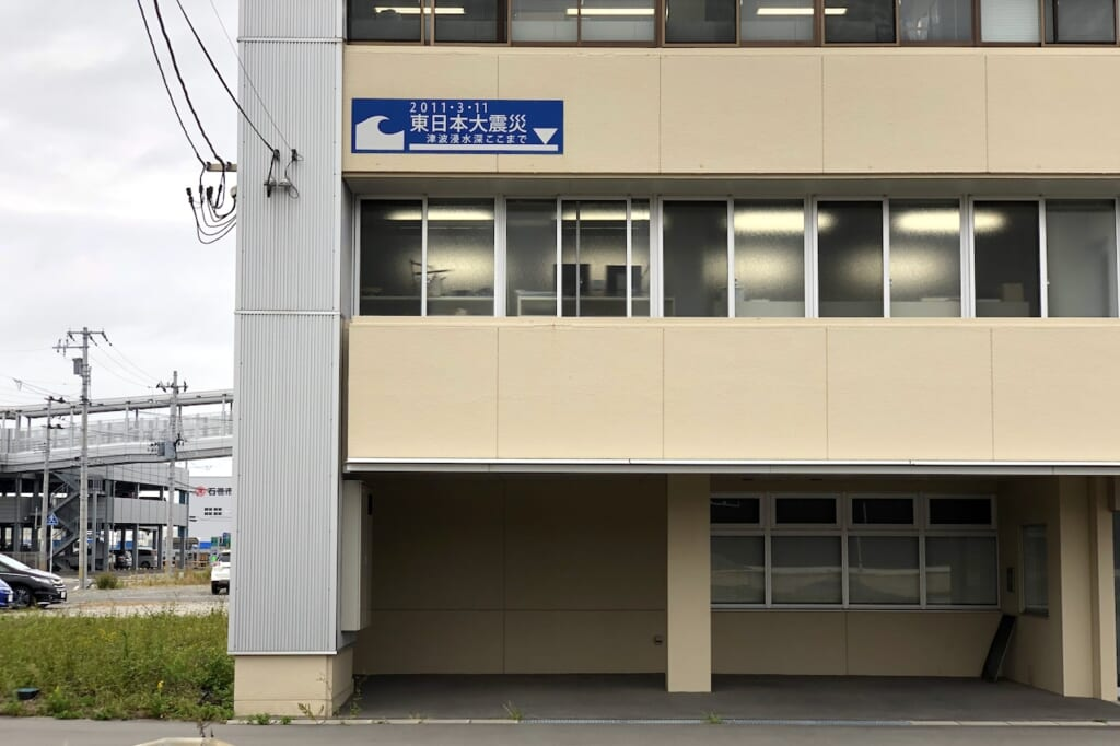 tsunami level sign on building in Japan