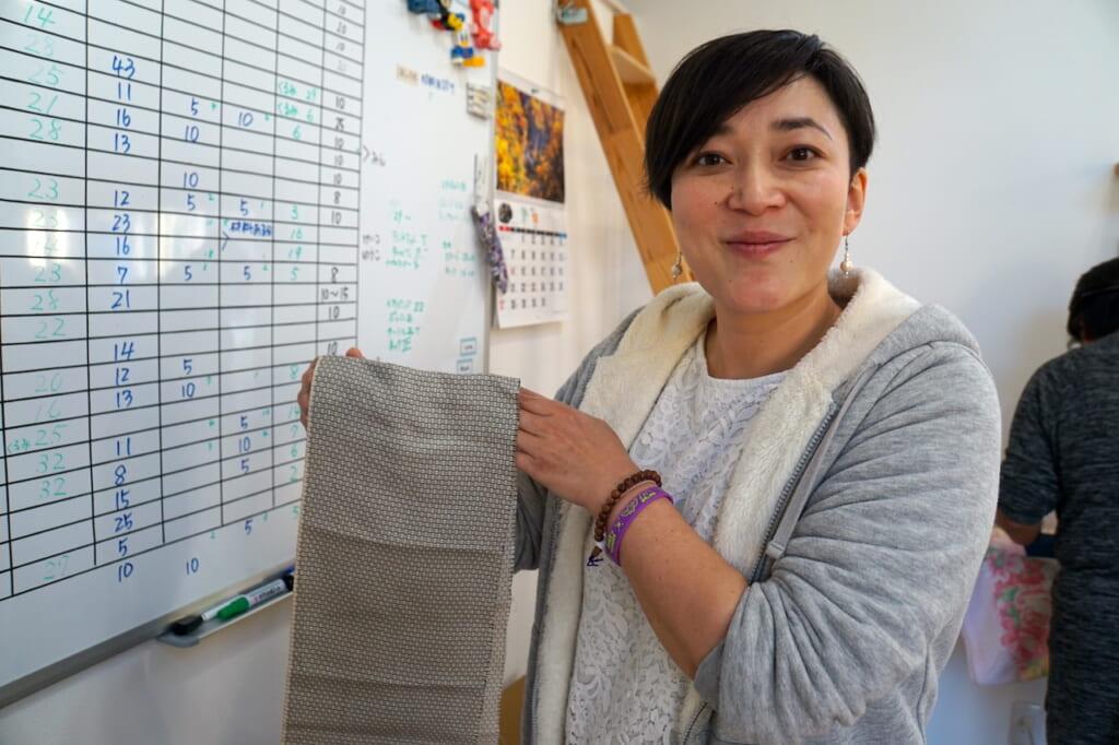 Japanese woman holding fabric in Tohoku region
