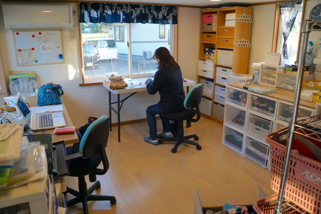 Japanese woman working at desk in trailer