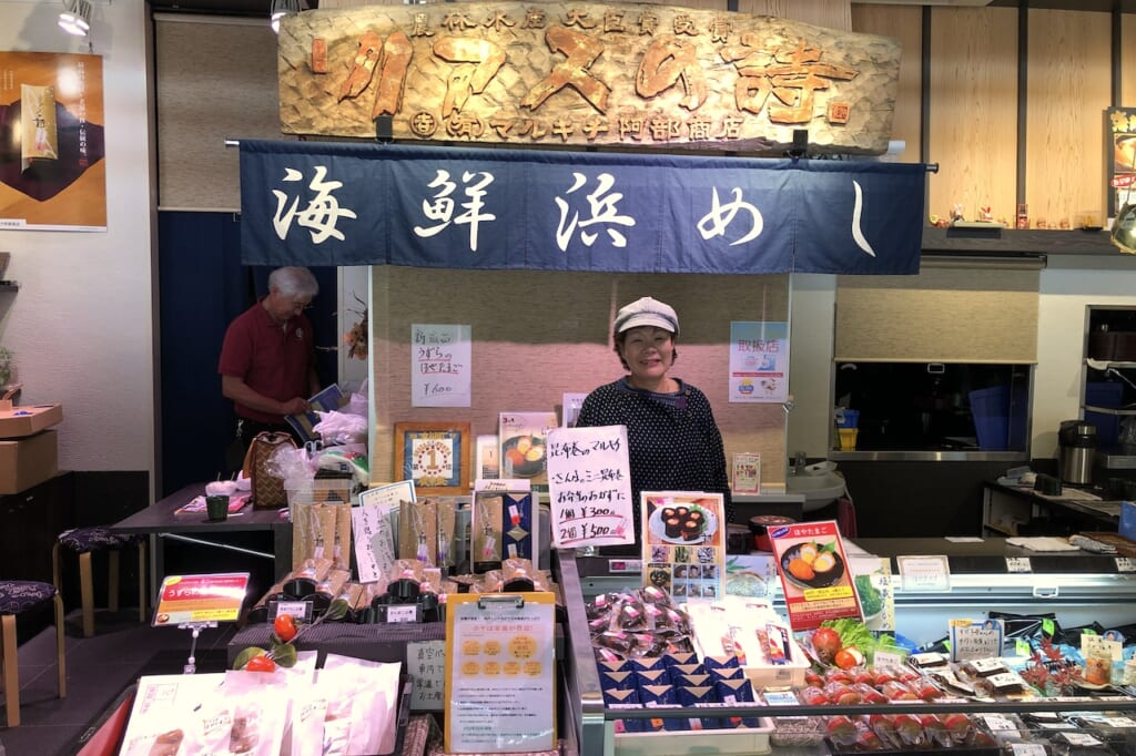 Japanese woman at seafood stall in Japan