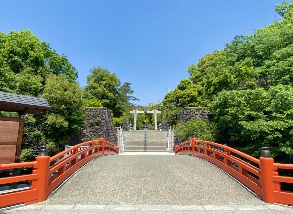 Japanese shrine with vermillion bridge in Japan