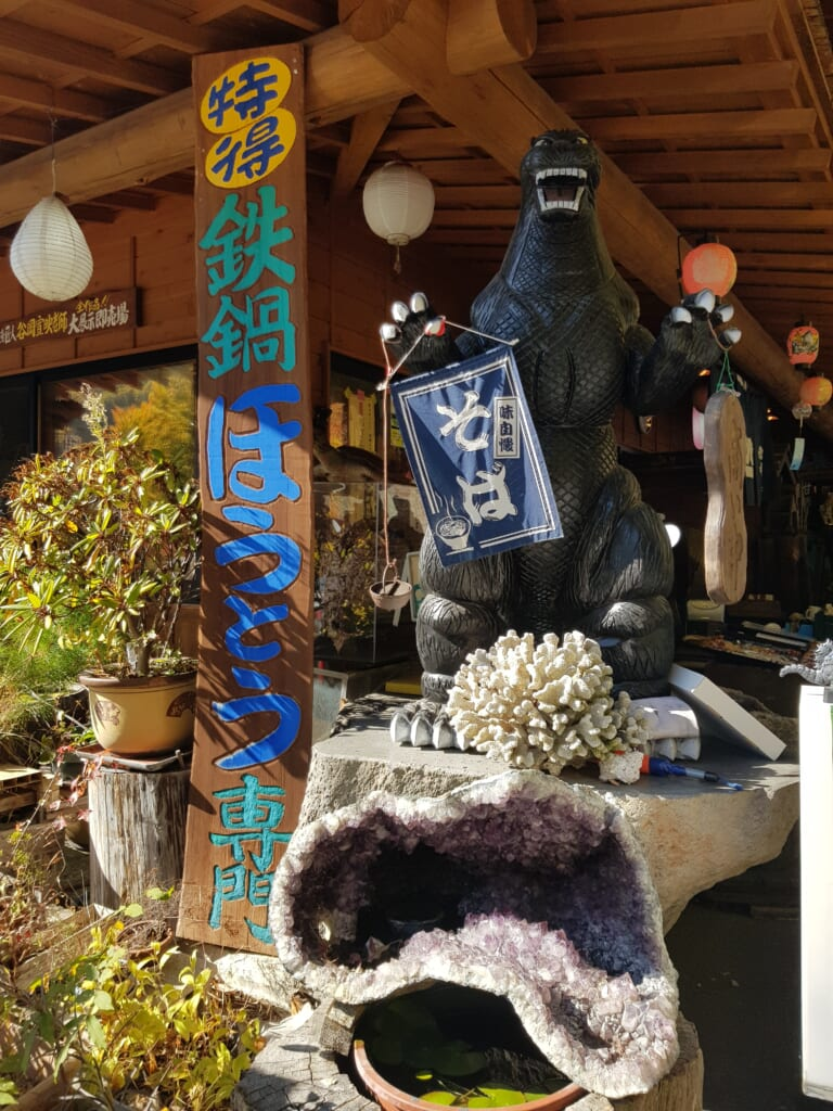 traditional Japanese restaurant in Japan with statue of Godzilla