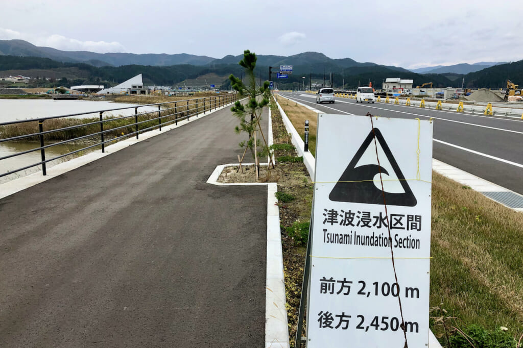 tsunami flood zone sign on road in Japan