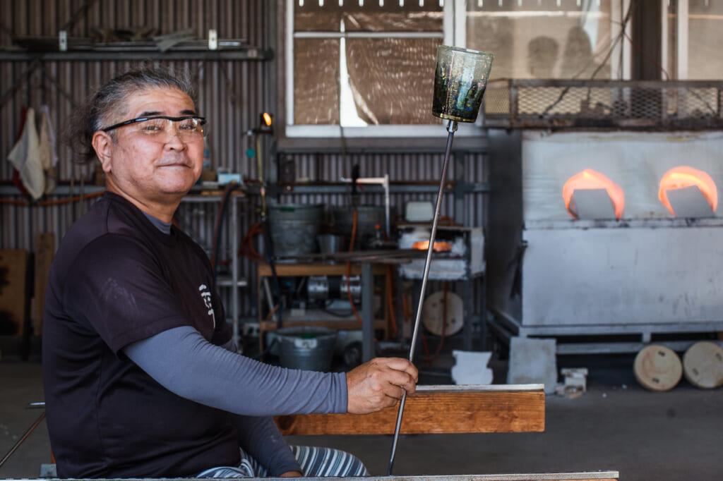 Japanese craftsman, Kaneshi showing his glass in his workshop in Japan