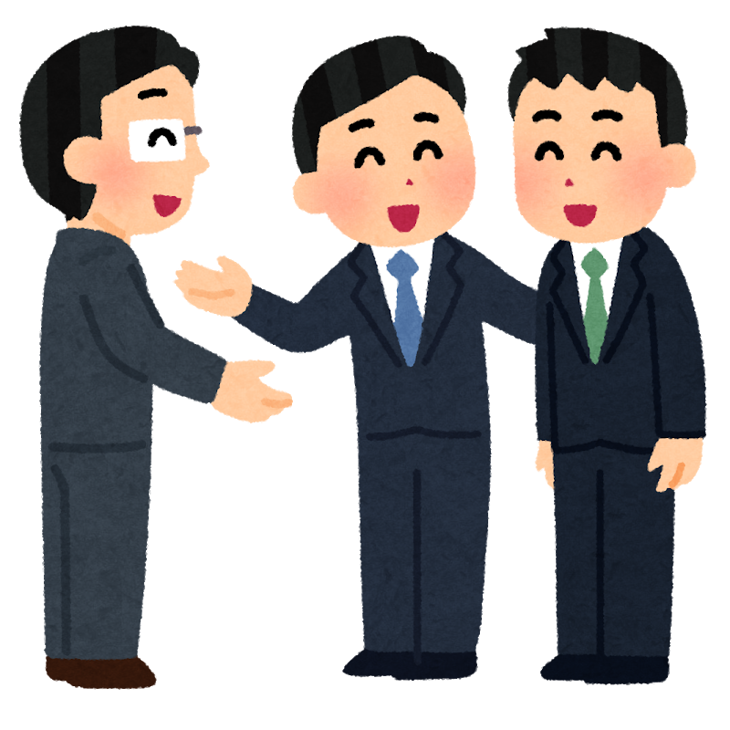 A man greeting two new members of the company
