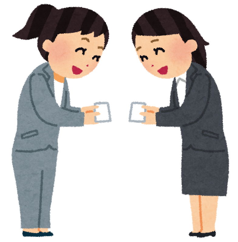 Exchanging business cards in a meeting
