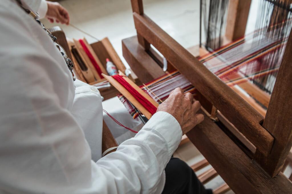 women weaving a japanese textiles