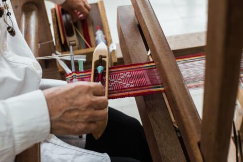 detail of women weaving a japanese textile
