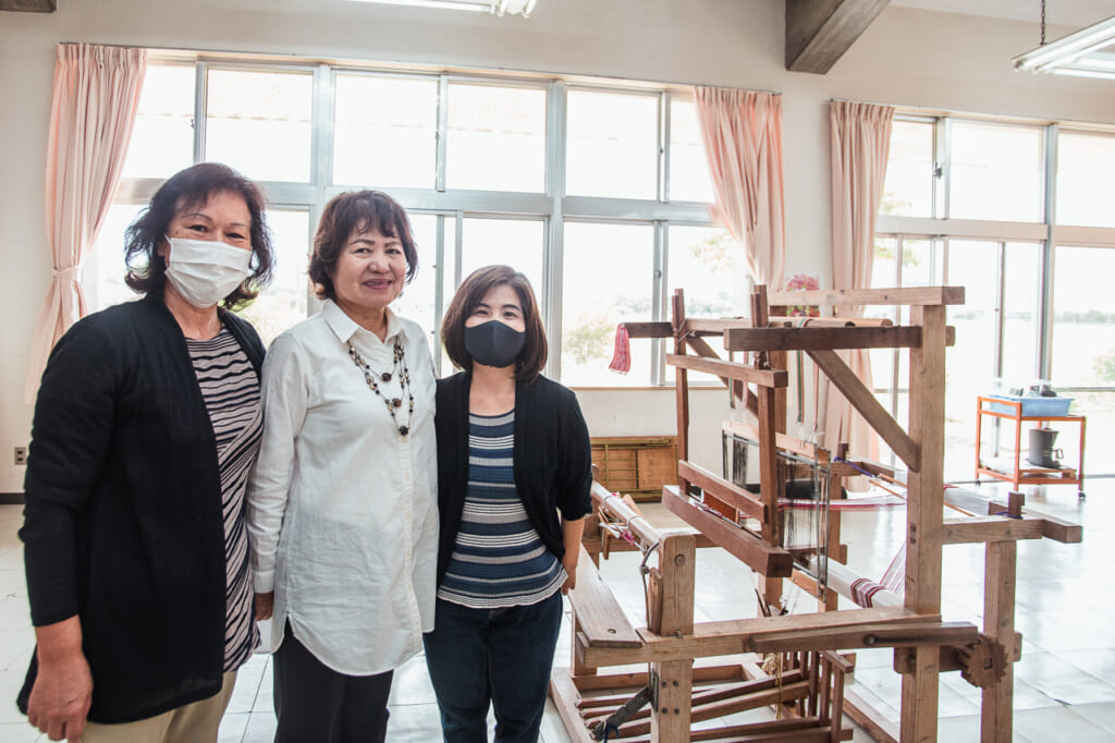women working in Yuntanza Hanaori, a traditional Japanese fabric