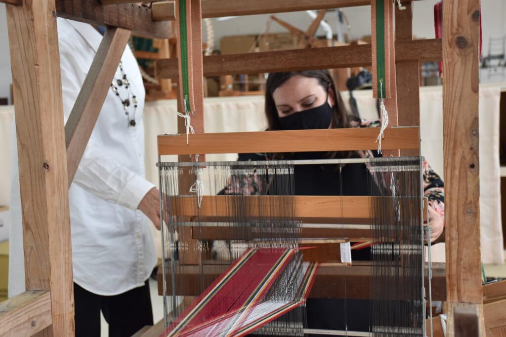 woman weaving hanaori textiles in japan