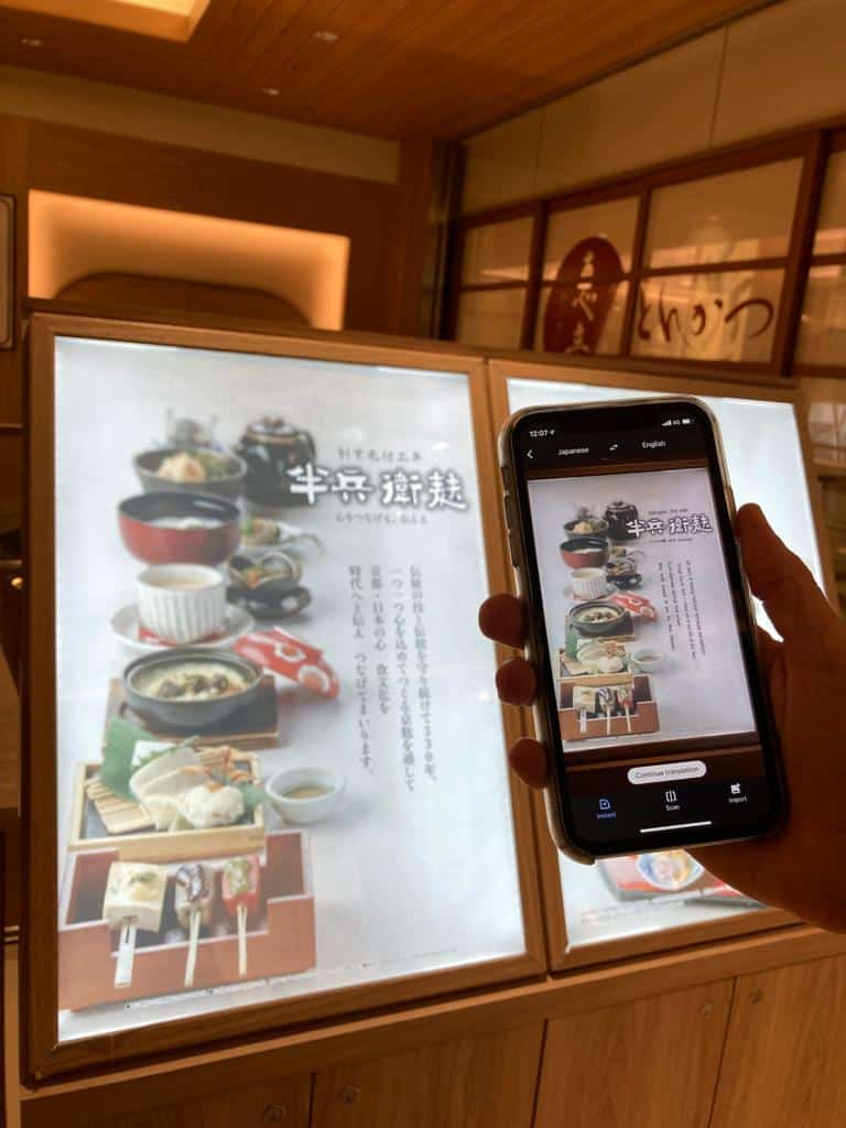 smartphone translating Japanese text with the google translation app