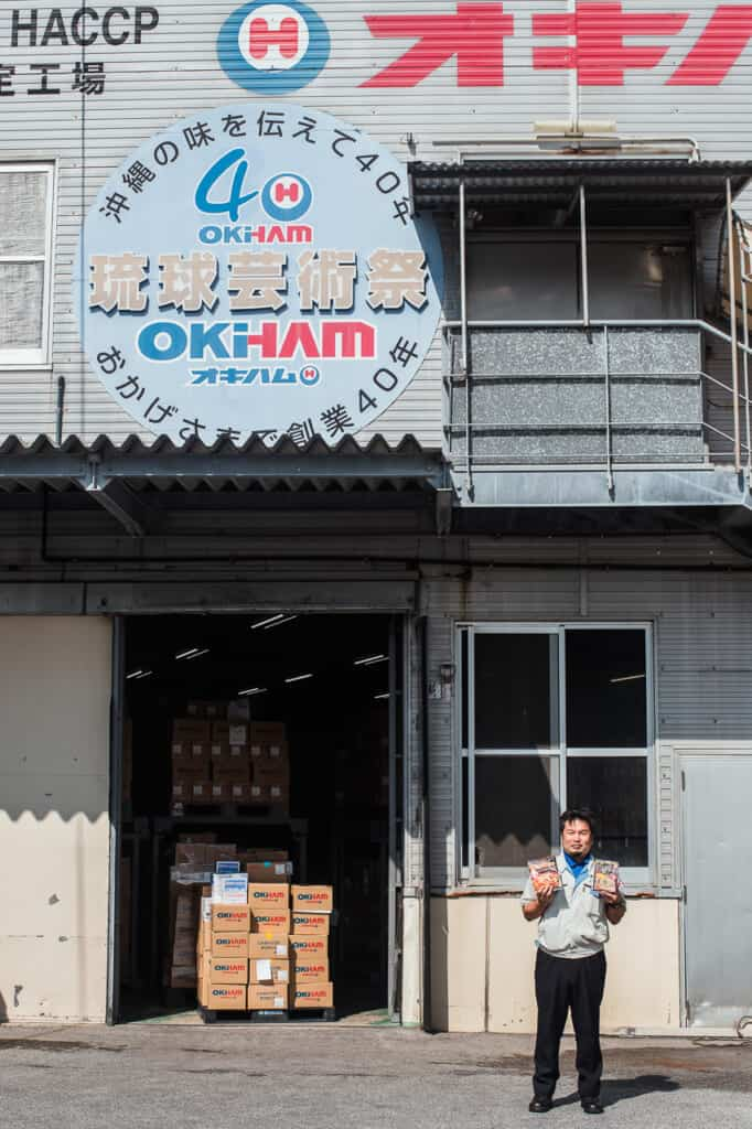 Japanese man in front of food company in Okinawa