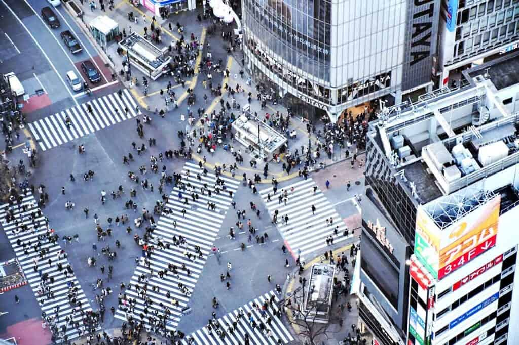 aerial view of pedestrians crossing a large city intersection in Japan