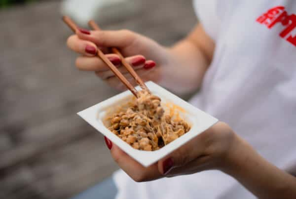 eating natto from a container with chopsticks in Japan