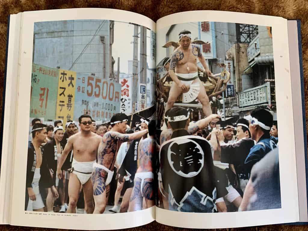 tattooed men on floats in Japan