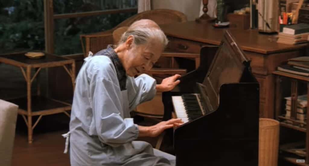 Rhapsody in August, Kane playing piano