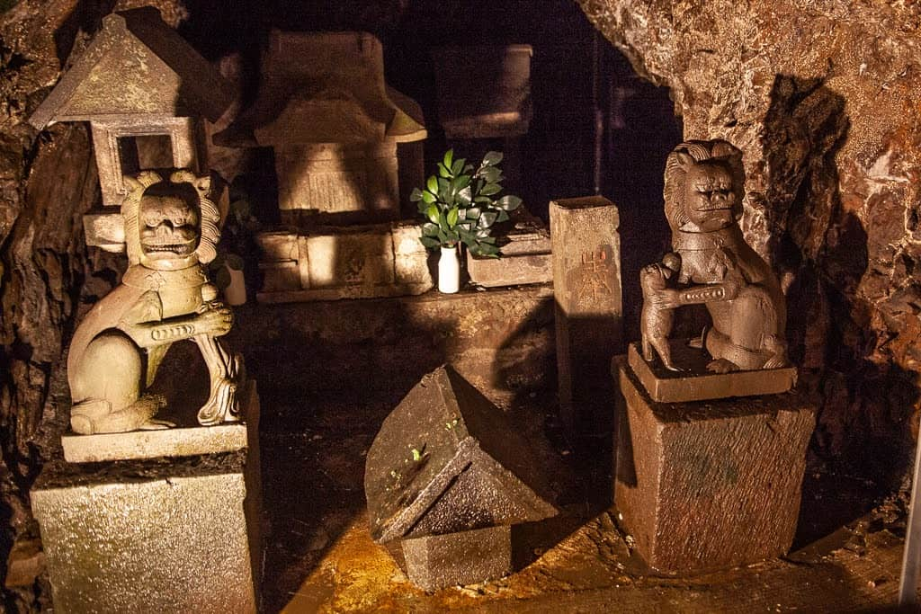 guardian dog statues in cave on Enoshima, Japan