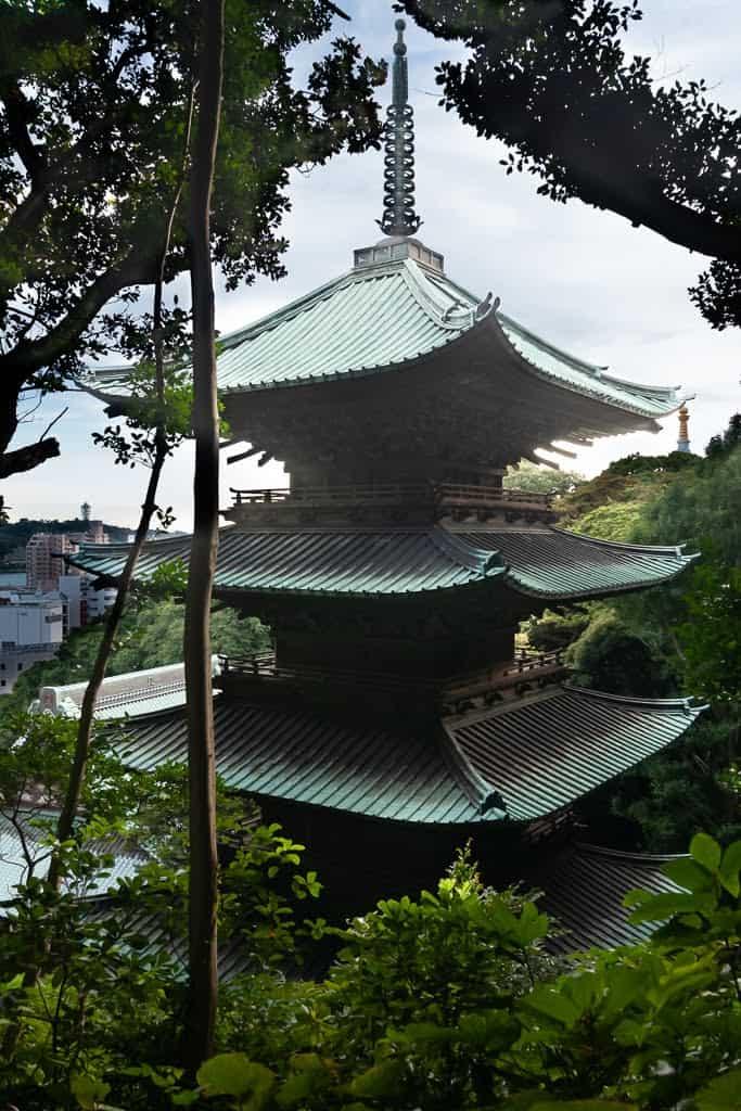 Japanese pagoda seen through trees