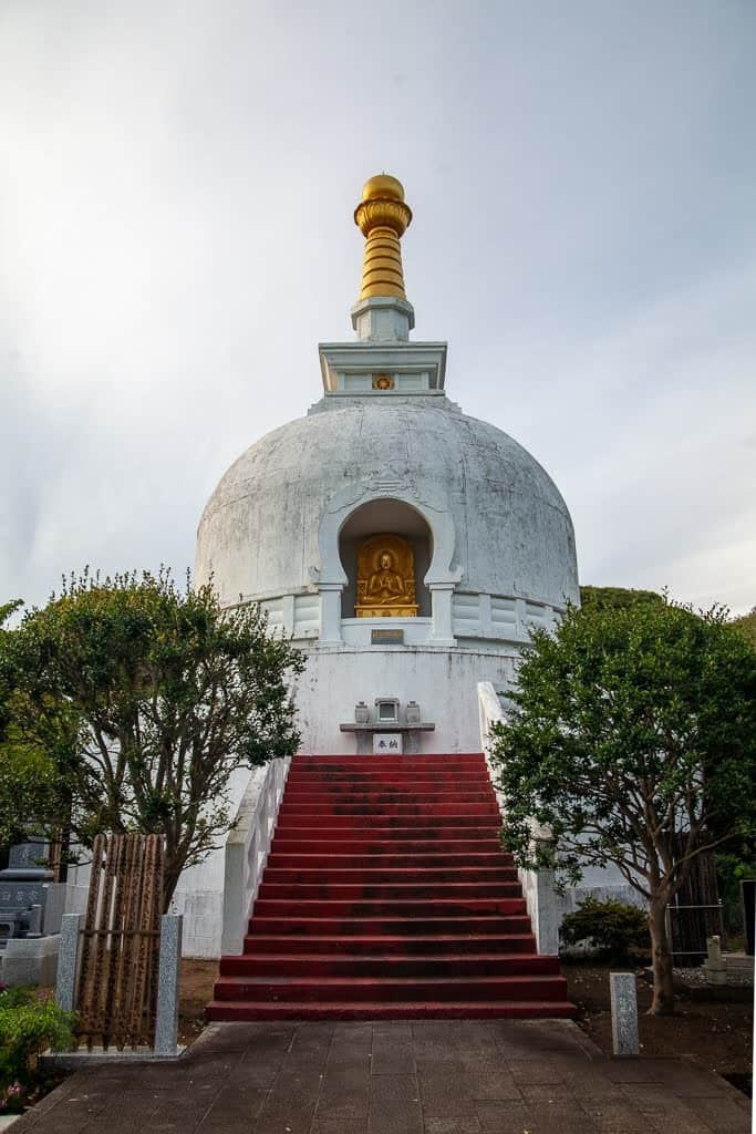 large white stupa structure in Japan