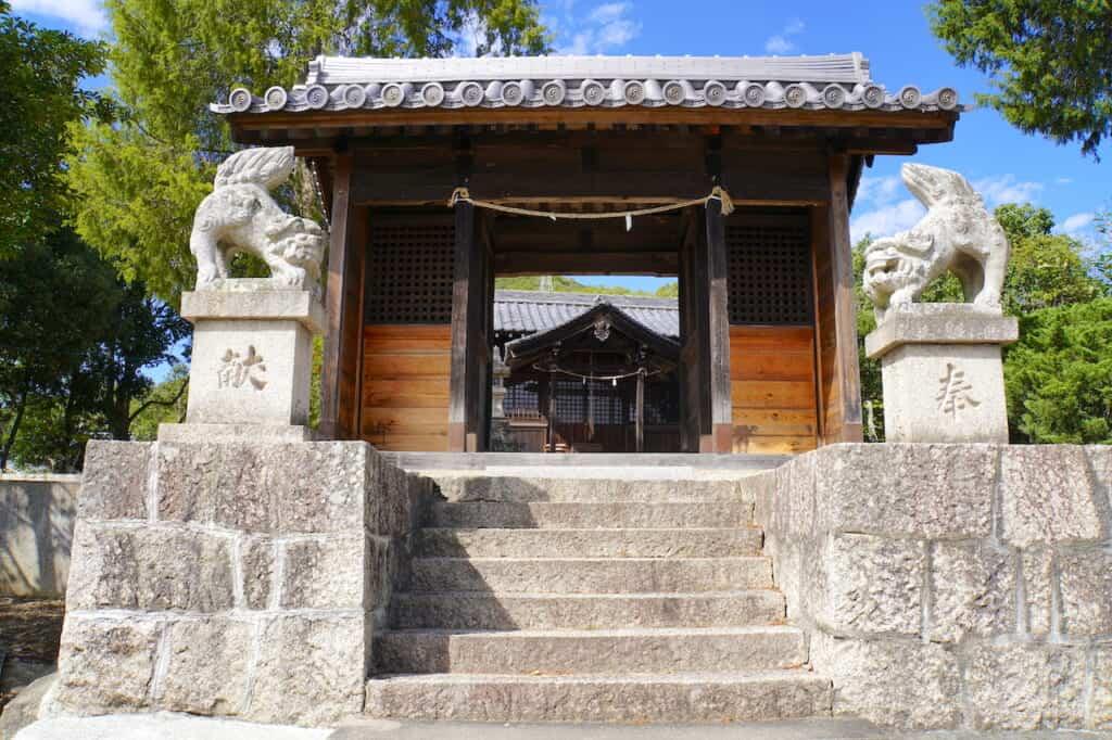 stone guardian lion dogs outside traditional Japanese shrine gate