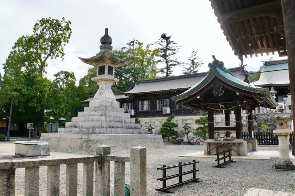 large stone lantern on Japanese shrine grounds along the Kibiji cycling route