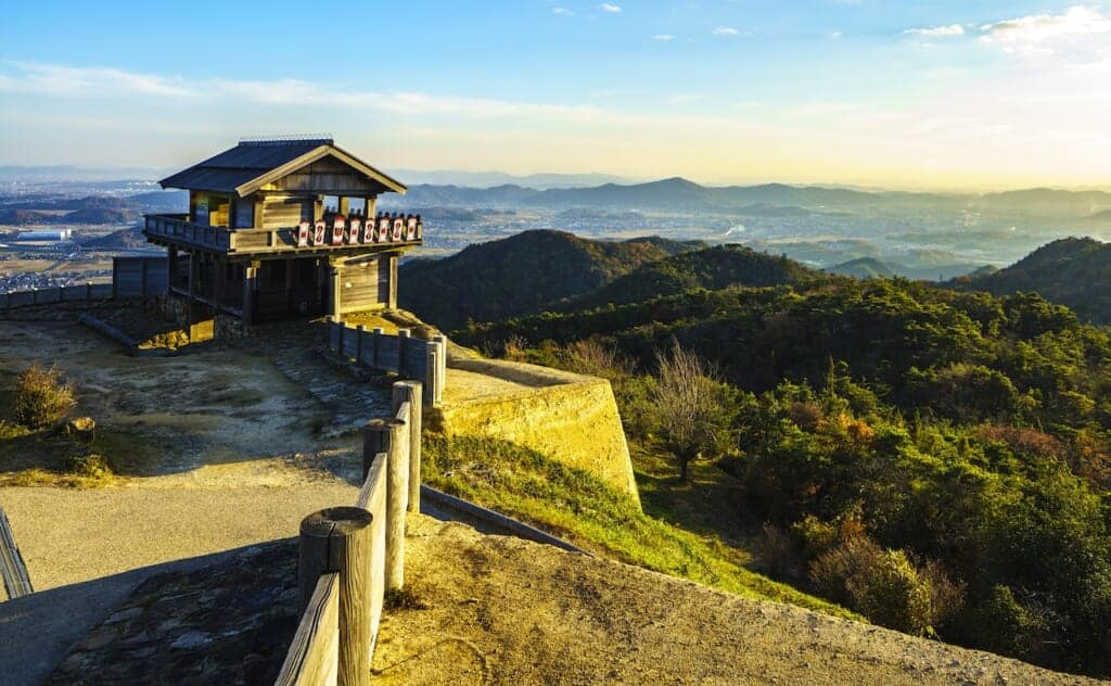 wooden turret perched on edge of mountain with panoramic view
