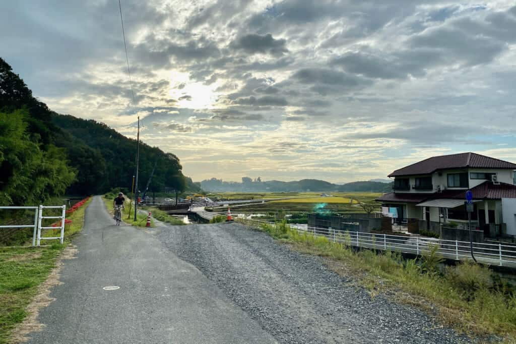 cyclist on rural bike path of Kibiji cycling route in Japan