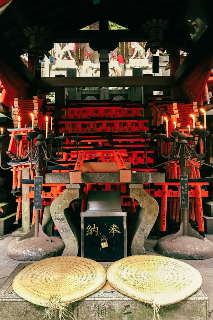 Offerings at Inari in Japanese shrine
