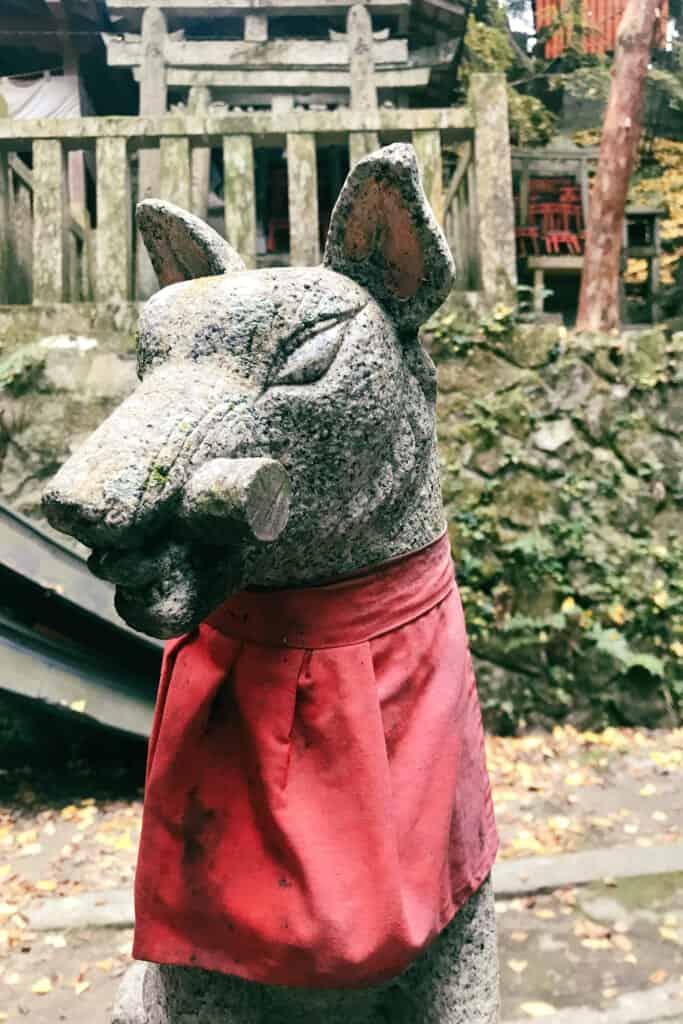 stone fox statue in Japan